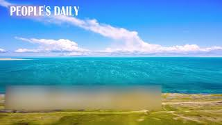 Spectacle is spotted in NW China's Qinghai that an ocean of cloud flows into Qinghai Lake.