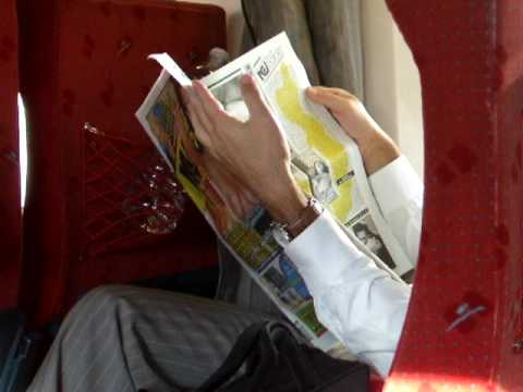 "Guy on the Paris-Amsterdam Train Reading a ""Porn-Newspaper"""