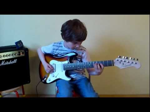 Dustin Tomsen 7 yr old practicing a fast guitar solo....