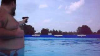 summer olympics redneck target practice, swimming pool, 9mm automatic, colt navy, ak47 ar15