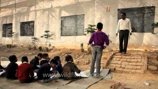 Mr. Rajesh Kumar taking classes under a metro bridge, New Delhi