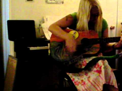 Michelle Hudson playing Guitar