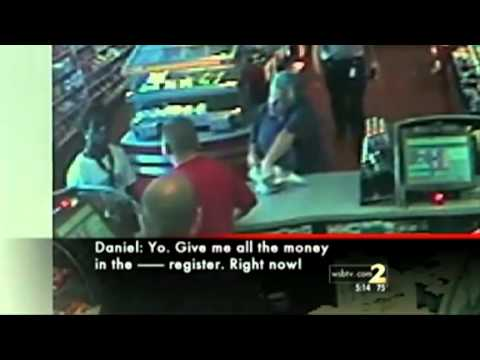 Black robs store with police officer standing right behind him