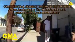 Body camera footage released of Black man arrested while taking out trash l GMA