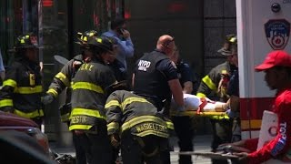 At least one dead as car hits crowd in Times Square