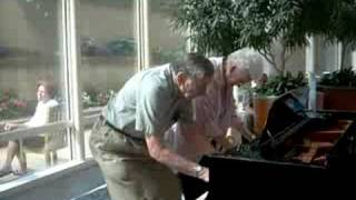 Mayo Clinic atrium piano, charming older couple...