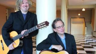 This video is a composite of moving and still images. The shor clips feature the two guitarists playing. The still images are photos of CD covers and the two of them performing.  (thumbnail)