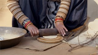 Free Video - A woman is rolling wheat dough with a rolling pin
