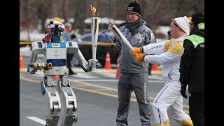 Robot HUBO carries 2018 Winter Olympics torch