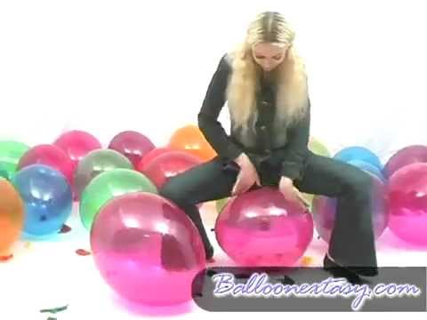 Woman sits on balloon and pops it