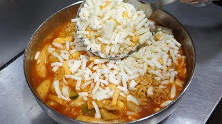 cheese spicy rice cake with noodles / korean street food