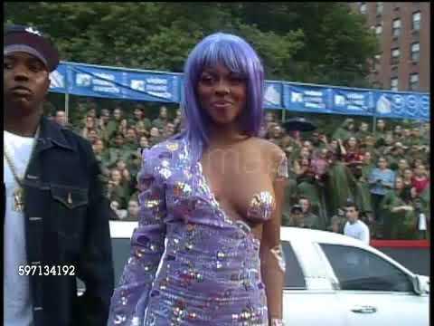 The Story Behind Lil Kim's Purple Jumpsuit