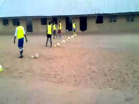 Players running back and forth picking the Ball Osfa Football Academy Nigeria, Africa.mp4