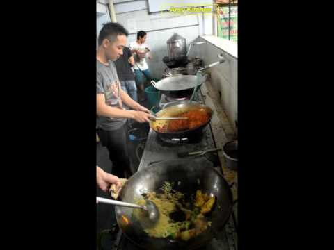 Chinese Street Food Cooking Vegetable Noodles in a Wok