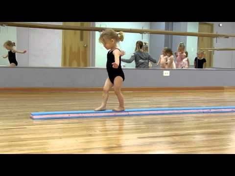 Ainsley mastering the balance beam at dance class