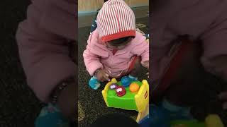 Vishika Playing with toys in plunket