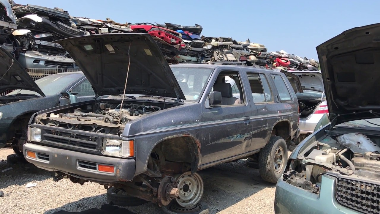 Old Nissan Pathfinder With A Very Rotten Frame At The Junk Yard