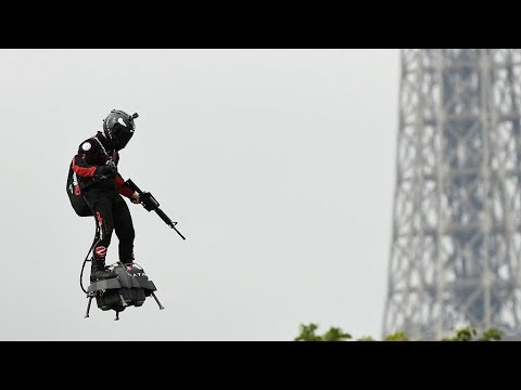 """a-""""flying-man""""-over-the-champs-elysees-at-bastille-day-celebration-in-paris"""