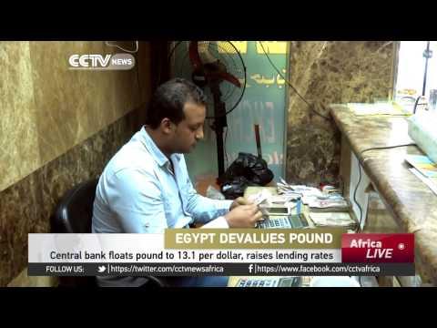 Egypt Central Bank Floats Pound To 13.1 Per Dollar, Raises Lending Rates