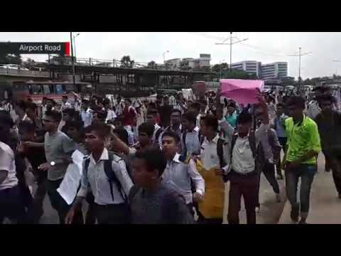 Hundreds of students from different colleges block the Airport Road in Dhaka