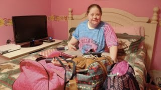 Woman with Down Syndrome faces daily challenges with a smile