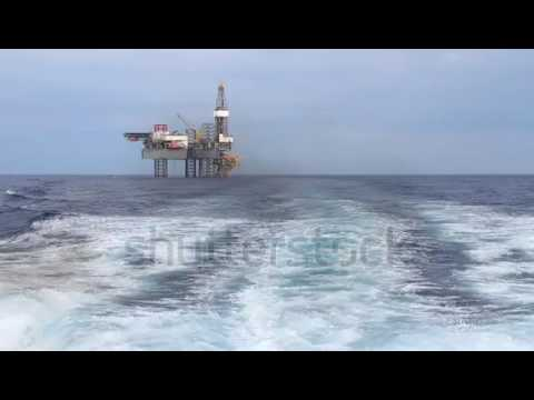 Offshore Jack Up Drilling Rig Over The Production Platform In The Middle Of The Sea   View From Crew