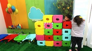 Masal and Öykü Wants to Play Hide and Seek! kids knitted wall with colorful boxes