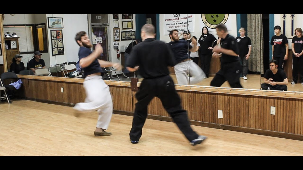 Download Youngster tries to kick 50 year old Tai Chi teacher...