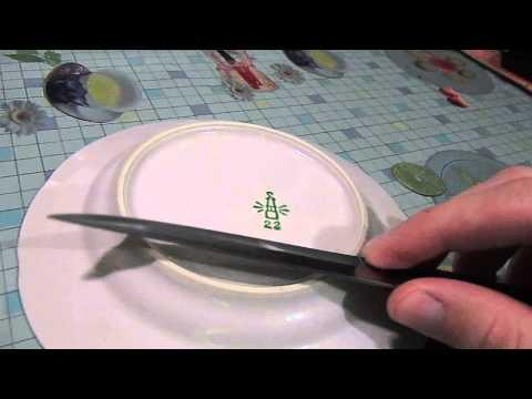 Заточка ножа на керамической тарелке