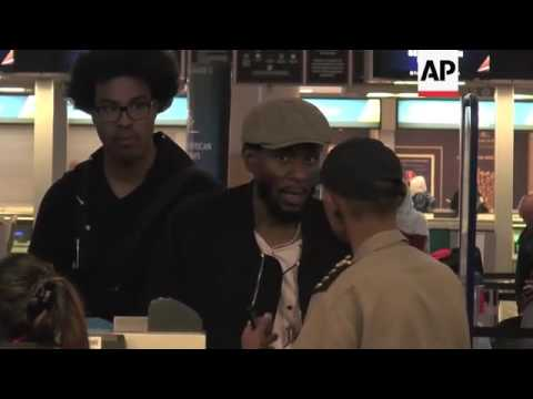 Mos Def escorted by immigration official at Cape Town International Airport