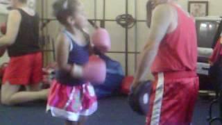 5 year old girl Muay Thai kickboxer and Zen Do Kai Karate gold medal winner training