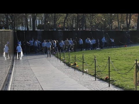 Volunteers clean the Vietnam Veterans Memorial