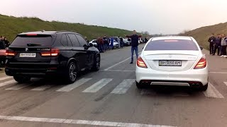 Bmw X5M 50D vs Mercedes 6.3 AMG dragracing