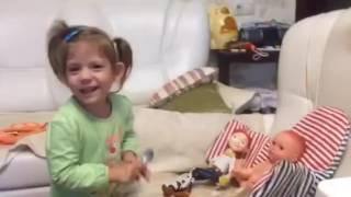 Василина кормит кукол