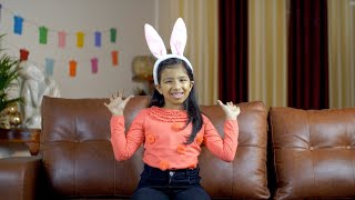 Smiling little kid in bunny ears playing peek a boo game at home - happy childhood