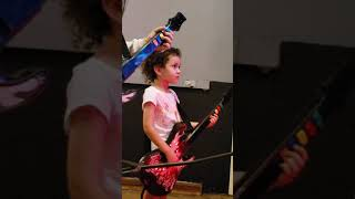 Emily playing guitar hero with her daughter Lulu