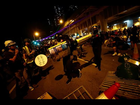 France 24:Live | Protesters in black using laser pointers have gathered at the Yuen Long station