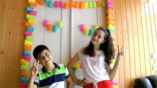 Guka and Maria Decorates Room Door with Colors Cups