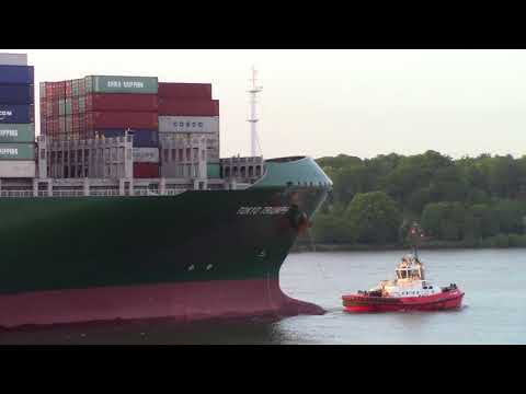 Large Container Ship TOKYO TRIUMPH on Elbe River at Sunset Inbound into Hamburg, Germany