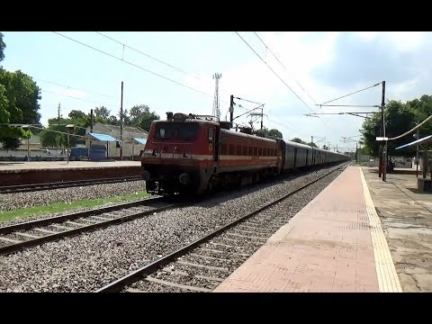 INDIAN RAILWAYS Coimbatore-NZM Kongu Express's 23 coaches with Lalaguda WAP4 at Dhaulpur Jn