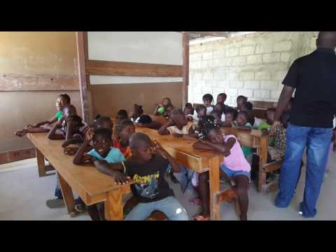A golgota Haitian Creole at Karade tent city school