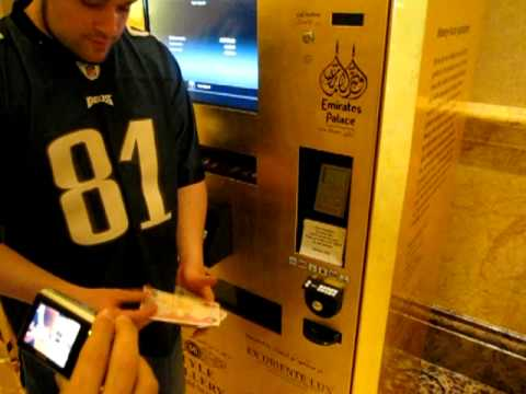Buying gold in a vending machine in Abu Dhabi at Emirates pa