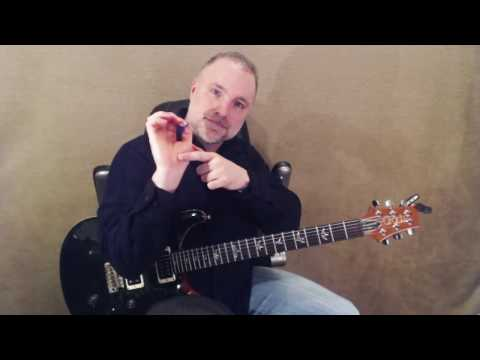 How To Hold The Electric Guitar