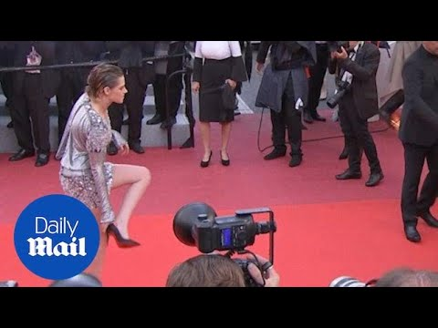 Kristen Stewart Poses In Metallic Dress Before Taking Her Heels Off