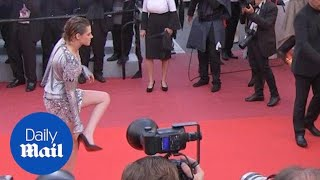 kristen stewart poses in metallic dress before taking her heels off   daily mail