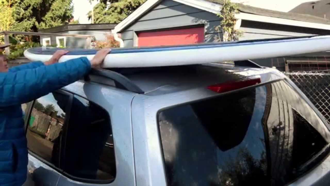 How to Tie a Surfboard or SUP to a Car with Roof Rails ...