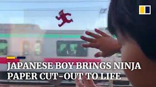 Japanese boy makes ninja paper cut-out 'run' on train window