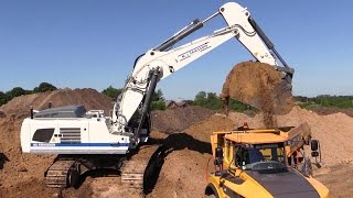 Liebherr R970 Super Mass Excavator Loading Dirt