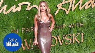Rita Ora lights up the red carpet in a slinky metallic dress - Daily Mail