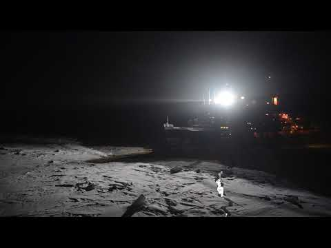 Raw video: Nuclear-powered icebreaker Yamal passing by our ship at night